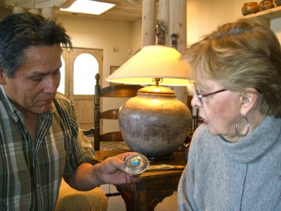 ron_bedonie_showing_marti_struever_his_silver_and_turquoise_buckle_400