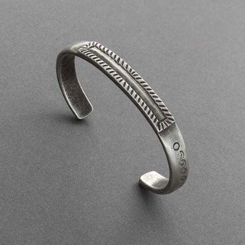 Olin Tsingine Bracelet of Coin Silver