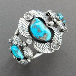 Navajo Bracelet of Turquoise With Silver Flower and Leaf